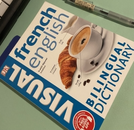 French English Billingual dictionary with a croissant and cup of coffee on the cover