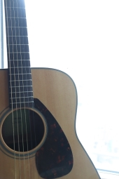 Guitar in front of a window